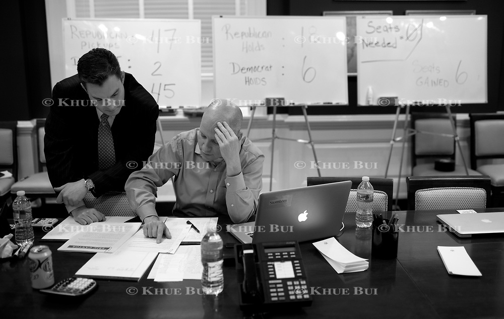 Republican Whip's Press Secretary Brad Dayspring (left) and Steve Stombres, Chief of Staff in the Whip's Office, look over announcements in the 'War Room' of the Whip's Office in the US Capitol November 2, 2010, in Washington, DC.  Sweeping victories by Republican House candidates leads to a change in party control of the US House...and Cantor is expected to become the next Majority Leader.   ****Image available in color and/or B&W****..Photo by Khue Bui