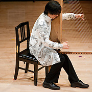 "February 18, 2012 - New York, NY : .Fuyuhiko Sasaki performs Toshi Ichiyanagi's 'Still Time II' (1986) on the kugo, an angular harp, during ""Resonances of the Kugo,"" part of the 2012 New York Music From Japan Festival, at Merkin Concert Hall on Saturday. .CREDIT: Karsten Moran for The New York Times"