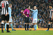 David Silva asks the ref during the Premier League match between Manchester City and Newcastle United at the Etihad Stadium, Manchester, England on 20 January 2018. Photo by George Franks.