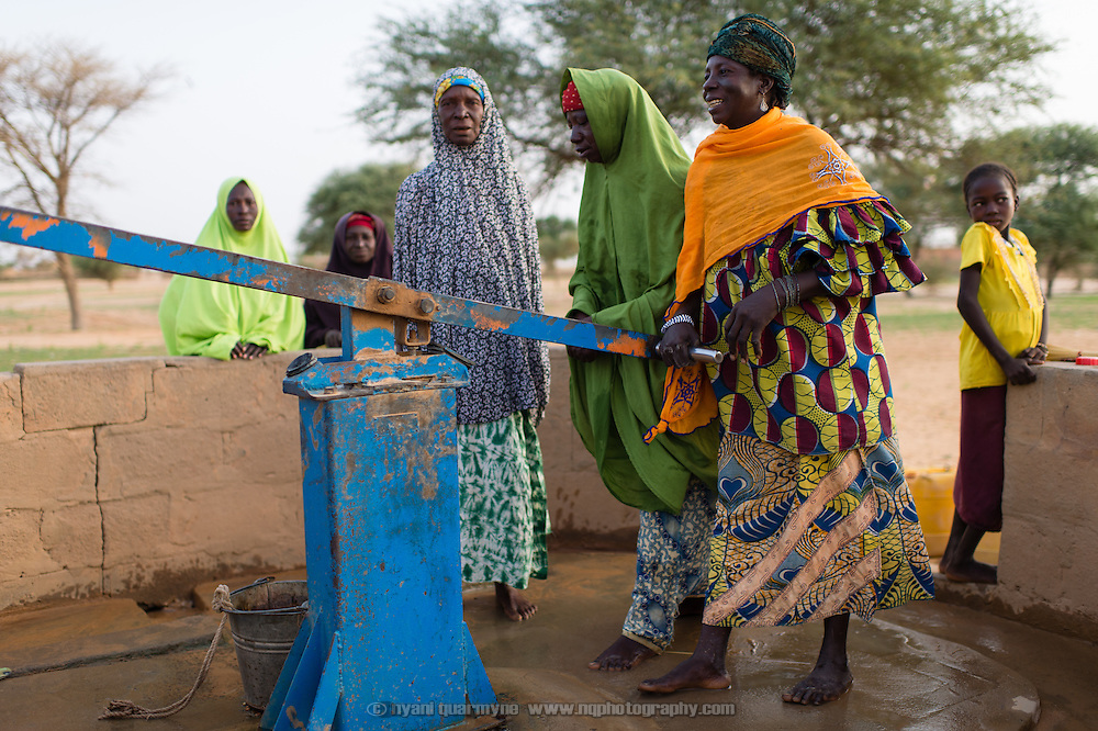 Women at a water pump in the village of Gadirga in the Commune of Soukoukoutan in the Dosso Region of Niger on 23 July 2013.