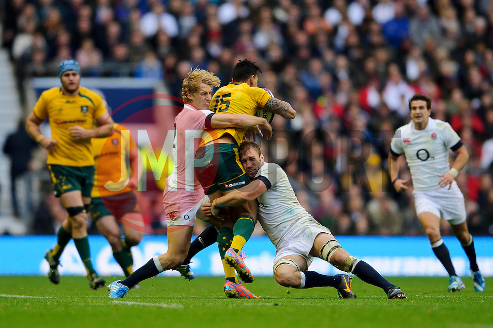 England Inside Centre (#12) Billy Twelvetrees (Gloucester Rugby)  and Flanker (#7) Chris Robshaw (Harlequins, capt) tackle Australia Full Back (#15) Israel Folau (NSW Waratahs) during the second half of the match - Photo mandatory by-line: Rogan Thomson/JMP - Tel: Mobile: 07966 386802 02/11/2013 - SPORT - RUGBY UNION -  Twickenham Stadium, London - England v Australia - Cook Cup - QBE Autumn Internationals.
