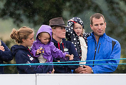 Image ©Licensed to i-Images Picture Agency. 02/08/2014. , United Kingdom. Peter Phillips with his daughter Savannah wife Autumn and daughter Isla (left) being held by the nanny. at theFestival of British Eventing. Gatcombe. Picture by i-Images