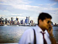A man talks on his phone on the Weehakwen/Port Imperial Ferry from mid town Manhattan to New Jersey. <br /> <br /> /// ADDITIONAL INFORMATION: 7/15/11 - travel.Lincoln.East.0929  - STUART PALLEY, ORANGE COUNTY REGISTER - Lincoln Highway July 2013.