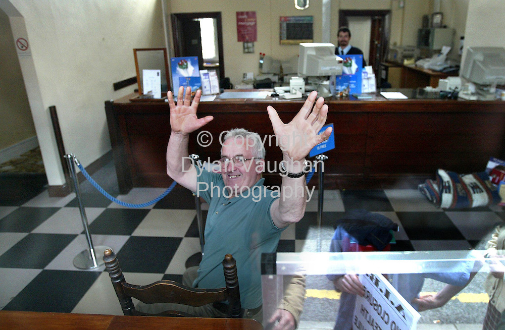 18/6/2002 Irish Independent News.Protester Tony Cullivan pictured inside  the Allied Irish Bank in Killenaule county Tipperary yesterday..Picture Dylan Vaughan