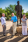 29 AUGUST 2012 - PARADISE VALLEY, AZ:   Dr. RICHARD CARMONA, Democratic candidate for US Senate from Arizona, (center, blue shirt) with TYLER ROSS GOLDWATER, left, and CC GOLDWATER in front of a statue of Barry Goldwater after a press conference in Barry Goldwater Memorial Park in Paradise Valley, AZ, Wednesday. Carmona won the endorsements of Joanne Goldwater, daughter of Barry Goldwater, the late legendary Republican Senator from Arizona. He was also endorsed by CC Goldwater, her daughter, and Tyler Ross Goldwater, CC Goldwater's son. Barry Goldwater was from Paradise Valley.  PHOTO BY JACK KURTZ