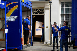 © Licensed to London News Pictures. 16/07/2016. London, UK. Boxes being removed from number 11 Downing Street. Removal men begin to take items from numbers 10 and 11 at Downing Street at the end of the week that saw Prime Minister David Cameron leave and Theresa May arrive. Photo credit: Ben Cawthra/LNP