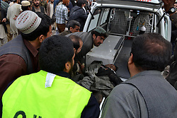 People move a body from the blast site in Quetta, southwest Pakistan, Jan. 10, 2013. At least ten were killed and over 35 others injured when a bomb hit Quetta Thursday afternoon, reported local media Dunya, Quetta, southwest PakistanJanuary 10, 2013. Photo by Imago / i-Images...UK ONLY