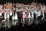 Newburgh, NY - Roosevelt Andre Credit and the All-County Chorus enjoy the applause from the crowd after performing in the Elementary All-County Music Festival at Newburgh Free Academy on April 28, 2007. The festival was presented by the Orange County Music Educators Association..