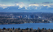 The Bellevue skyline, photographed from the Columbia Tower in Seattle, is nestled between the Cascade mountains in the background and Lake Washington in the foreground. (Ellen M. Banner/The Seattle Times)