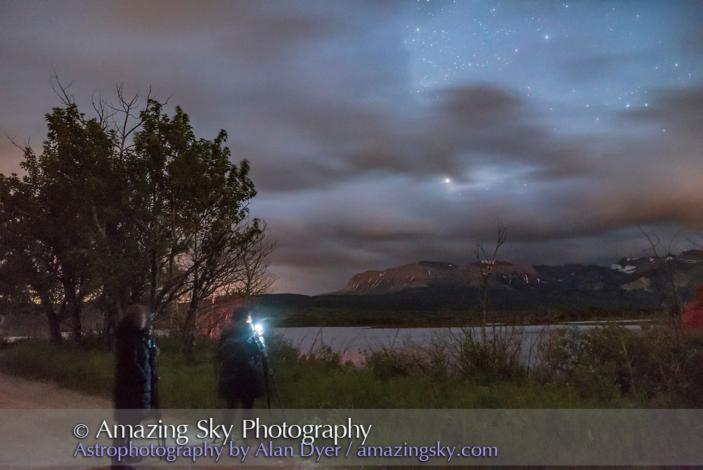 Participants at my Night Photography Workshop on JUne 15, 2017 at Maskinonge Pond at Waterton Lakes National Park, Alberta, on a mostly cloudy night. Saturn is the bright object just peeking through the clouds.
