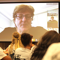 Dr. Meg Urry, a Physics professor at Yale, talks with a group of Mississippi high School students during their lesson through video-conference Monday afternoon at Mississippi State University. The students are taking AP summer prep courses preparing them forupcoming AP Physics this school year.