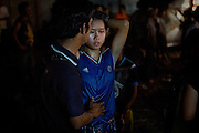After loosing to her opponent during a Muay Thai boxing match, Phatsorn Bunmasen, 14, is being comforted by her father at en event organised in a village near Ubon Ratchathani, northeast Thailand.