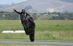 A trick motorcyclist displays his skills at the Tauranga City Airshow, Tauranga, New Zealand, Saturday, January 20,  2018. Credit:SNPA / Richard Moore **NO ARCHINVING**