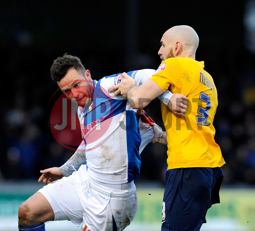 Bristol Rovers' Chris Beardsley's shirt is pulled by Oxford United's Tom Newey - Photo mandatory by-line: Dougie Allward/JMP - Tel: Mobile: 07966 386802 08/02/2014 - SPORT - FOOTBALL - Bristol - Memorial Stadium - Bristol Rovers v Oxford United - Sky Bet League Two