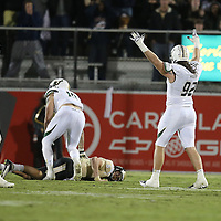 South Florida Bulls defensive tackle Luke Sager (92) reacts after UCF Knights quarterback Blake Bortles (5) throws an interception late in the game during an NCAA football game between the South Florida Bulls and the 17th ranked University of Central Florida Knights at Bright House Networks Stadium on Friday, November 29, 2013 in Orlando, Florida. (AP Photo/Alex Menendez)