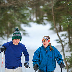 A couple cross country skiing in the backcountry of Maine's Katahdin Woods and Waters National Monument.