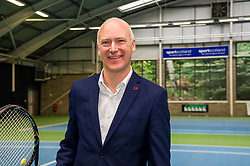 Pictured: Joe FitzPatrick<br /> <br /> Today, Sports Minister Joe FitzPatrick visited Craiglockhart Tennis centre to announce funding to help women and girls across Scotland take part in sport or physical activity. The fund's launch is part of the second annual Scottish Women and Girls in Sport Week.<br /> <br /> During his visit to the Centre, Mr FitzPatrick met the Chair, Mel Young, and  representatives from sportscotland as well as participants, coaches and staff.