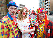 Clowns annual church service <br /> at All Saints Church, Haggerston, London, Great Britain <br /> 7th February 2017 <br /> <br /> 71st Clowns International Annual Grimaldi Service <br /> The first Grimaldi Service was held in 1946 around Grimaldi's grave at the old St. James Church Pentonville Road, islington, The Circus Clowns Club now Clowns International was formed the following year. <br /> <br /> Officiating priest is Revd. Richenda Wheeler <br /> <br /> A service for clowns both past and present young and old where many dress up in their clown costumes each year. <br /> <br /> Photograph by Elliott Franks <br /> Image licensed to Elliott Franks Photography Services