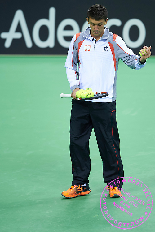 Dawid Celt with official balls during official training session two days before the Fed Cup / World Group 1st round tennis match between Poland and Russia at Krakow Arena on February 5, 2015 in Cracow, Poland<br /> Poland, Cracow, February 5, 2015<br /> <br /> Picture also available in RAW (NEF) or TIFF format on special request.<br /> <br /> For editorial use only. Any commercial or promotional use requires permission.<br /> Adam Nurkiewicz declares that he has no rights to the image of people at the photographs of his authorship.<br /> Mandatory credit:<br /> Photo by &copy; Adam Nurkiewicz / Mediasport