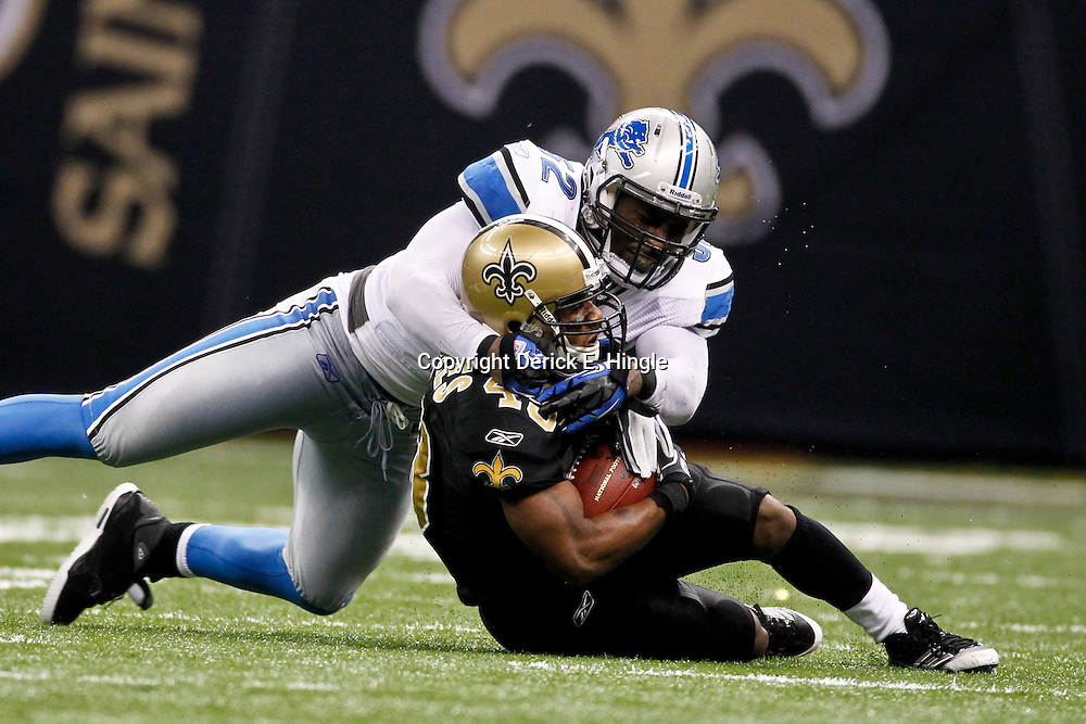 January 7, 2012; New Orleans, LA, USA; Detroit Lions defensive end Cliff Avril (92) tackles New Orleans Saints running back Darren Sproles (43) during the 2011 NFC wild card playoff game at the Mercedes-Benz Superdome. Mandatory Credit: Derick E. Hingle-US PRESSWIRE