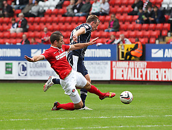 Charlton Athletic's Dorian Dervite tackles Millwall's Martyn Woolford - Photo mandatory by-line: Robin White/JMP - Tel: Mobile: 07966 386802 21/09/2013 - SPORT - FOOTBALL - The Valley - Charlton - Charlton Athletic V Millwall - Sky Bet Championship