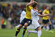 Oxford United defender Joe Skarz (3) man handles AFC Wimbledon midfielder Jake Reeves (8) during the Sky Bet League 2 match between Oxford United and AFC Wimbledon at the Kassam Stadium, Oxford, England on 10 October 2015.