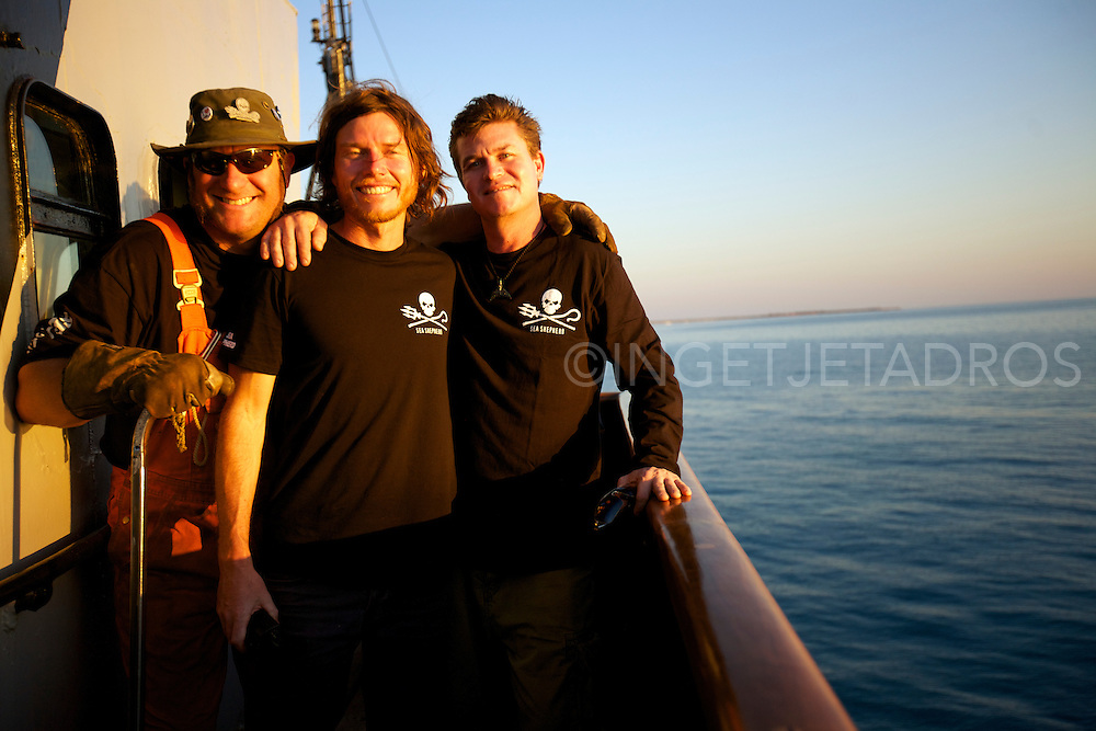 Marc 'The whale welder' standing together with Captain Mal Holland and Manager of the Seashepherd Beck Straussner outside on the 'Steve Irwin.'