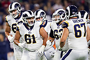 HOUSTON, TX - AUGUST 29:  Jeremiah Kolone #61 and the offensive line of the Los Angeles Rams break the huddle during a game against the Houston Texans during week four of the preseason at NRG Stadium on August 29, 2019 in Houston, Texas. The Rams defeated the Texans 22-10.   (Photo by Wesley Hitt/Getty Images) *** Local Caption *** Jeremiah Kolone
