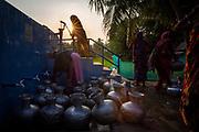 Women using a WaterAid & Rupantar installed village water sand filtration system. WaterAid Bangladesh working with the local partner Rupantar, Shaymnagar,  Satkhira District, Bangladesh.  (Image © Andy Aitchison)