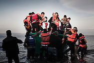 Refugees from Afghanistan and Syria arrive in a life boat on the shores of Lesbos near Skala Sikaminias, Greece on 10<br /> November, 2015. Lesbos, the Greek vacation island in the Aegean Sea between Turkey and Greece, faces massive refugee flows from the Middle East countries.