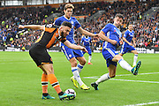 Hull City midfielder Robert Snodgrass (10) crosses ball against Chelsea defender Marcos Alonso (3) and Chelsea defender Gary Cahill (24)  during the Premier League match between Hull City and Chelsea at the KCOM Stadium, Kingston upon Hull, England on 1 October 2016. Photo by Ian Lyall.