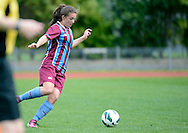 Kate Guilford of Football South looks for options, in the ASB women's league match between Football South and Auckland Football, at the Caledonian Ground, Dunedin, New Zealand,  20 October 2013. Credit: Joe Allison / allisonimages.co.nz