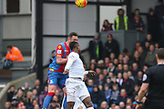 Damien Delaney (27) of Crystal Palace wins a header against Liverpool forward Divock Origi (27)  during the Barclays Premier League match between Crystal Palace and Liverpool at Selhurst Park, London, England on 6 March 2016. Photo by Phil Duncan.