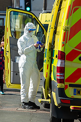 © Licensed to London News Pictures. 04/04/2020. Watford, UK. A paramedic wearing personal protective equipment outside an address in Watford. Paramedics responded to a medical incident in Watford, an ambulance an two incident response units attended   Photo credit: Peter Manning/LNP
