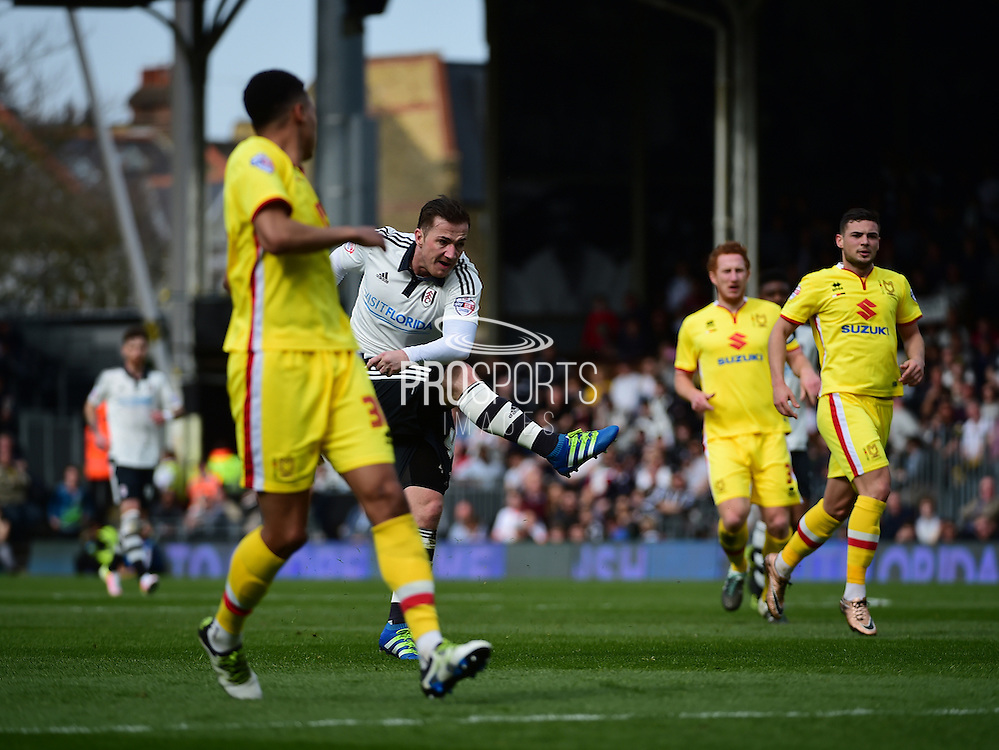 Fulham Forward Ross McCormack (44)takes a shot during the Sky Bet Championship match between Fulham and Milton Keynes Dons at Craven Cottage, London, England on 2 April 2016. Photo by Jon Bromley.