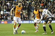 Hull midfielder Robert Snodgrass takes the ball past Derby defender Marcus Olsson during the Sky Bet Championship match between Derby County and Hull City at the iPro Stadium, Derby, England on 5 April 2016. Photo by Aaron  Lupton.