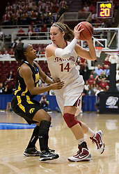 March 22, 2010; Stanford, CA, USA;  Stanford Cardinal forward Kayla Pedersen (14) is guarded by Iowa Hawkeyes guard Kachine Alexander (21) during the first half in the second round of the 2010 NCAA womens basketball tournament at Maples Pavilion. Stanford defeated Iowa 96-67.