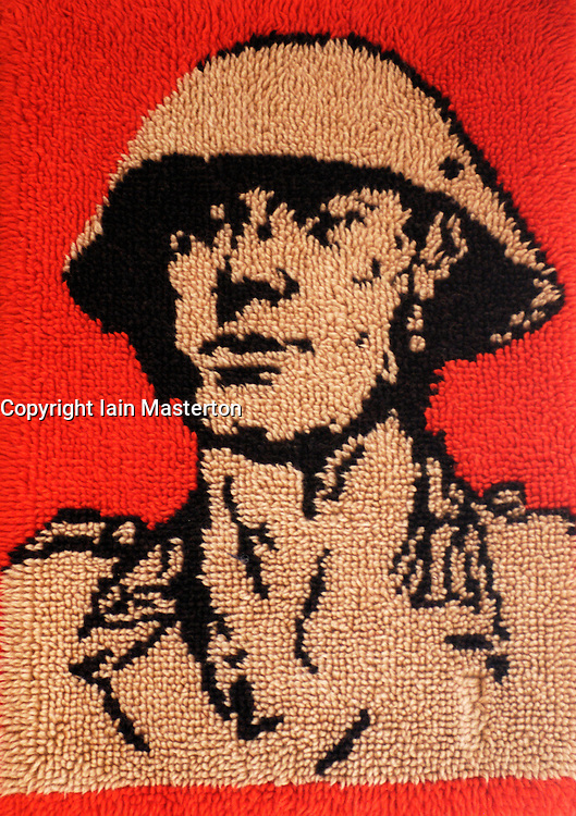 Detail of tapestry with East German soldier motif at Stasi Museum in Berlin Germany