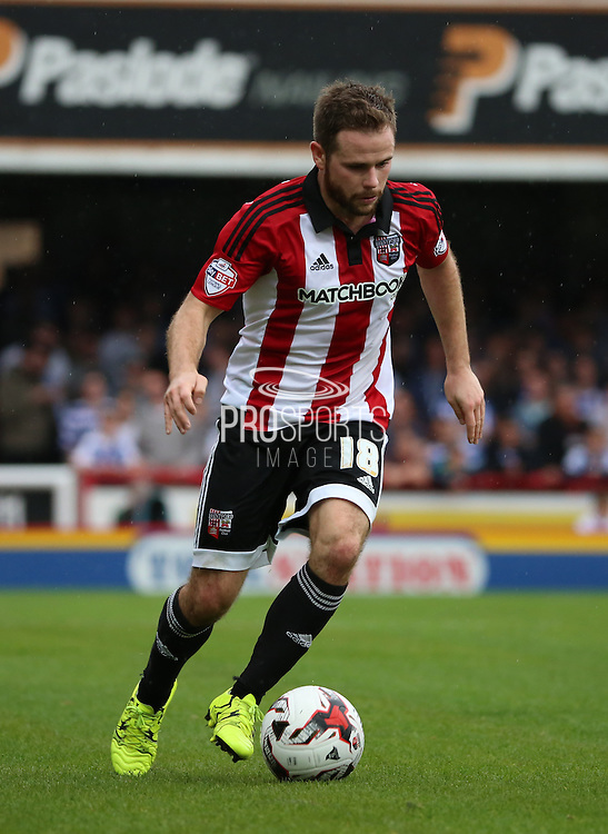 Alan Judge (Brentford midfielder) dribbling, trying to get Brentford into the game during the Sky Bet Championship match between Brentford and Reading at Griffin Park, London, England on 29 August 2015. Photo by Matthew Redman.