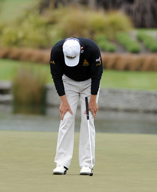 Queensland's Brad Kennedy hangs his head after missing the putt to win outright before a playoff with Craig Parry on the final round of the BMW New Zealand Golf Open, Clearwater, Christchurch, New Zealand, Sunday, December 04, 2011. Credit:SNPA / Ross Setford