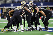 The New Orleans Saints offense huddles and calls a play during the NFL week 13 regular season football game against the Dallas Cowboys on Thursday, Nov. 29, 2018 in Arlington, Tex. The Cowboys won the game 13-10. (©Paul Anthony Spinelli)