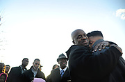 John Ford, of Adamsville, hugs his nephew Jakobe Streeter, 13,  of Center Point, after bringing him to the vigil for Jarmaine Walton to show him how one death affects the whole community, Wednesday, March 20, 2013. (Tamika Moore | tmoore@al.com)