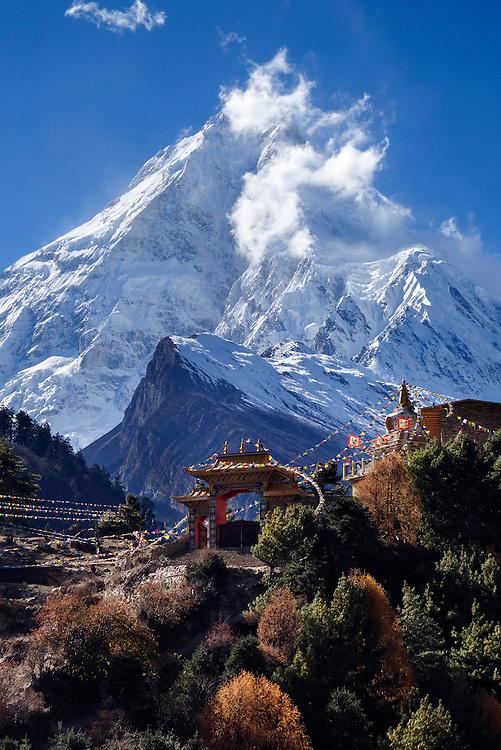 Manaslu peak looming over the new monastary in Lho, Nepal.