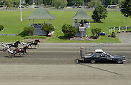 Goshen, NY -  The starting gate car pulls away as horses start a race at Goshen's Historic Track on June 7, 2008.