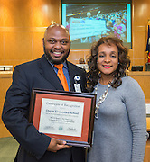 Trustee Rhonda Skillern-Jones presents a recognition to Dogan Elementary School principal Tarrieck Rideaux during a meeting of the Houston ISD Board of Trustees, April 14, 2016.