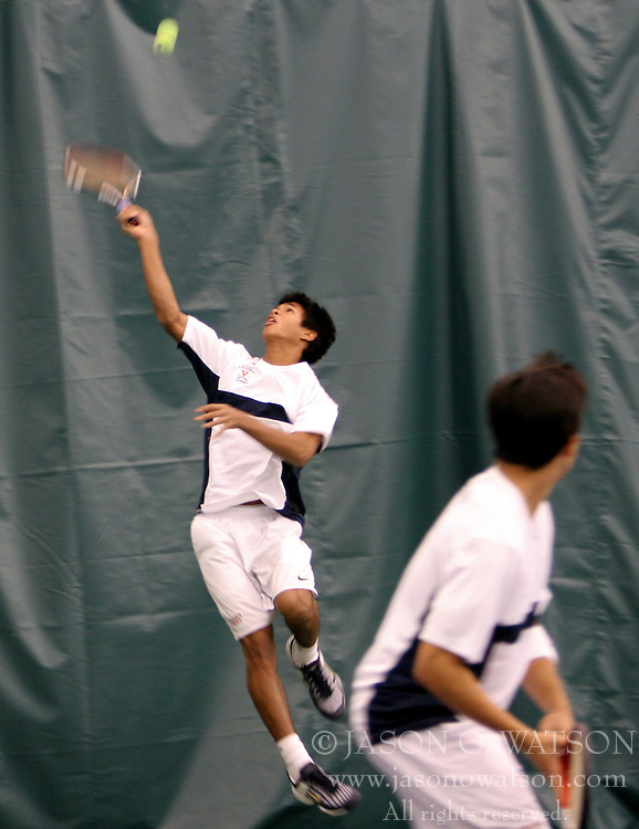 Somdev Devvarman reaches for a deep overhead ball as his doubles partner, Treat Huey looks on.  Devvarman and Huey defated the #1 doubles team from the University of Texas, 9-8.  UVA lost the overall match, 4-3.