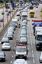 © Licensed to London News Pictures. 22/07/2016<br /> The big summer holiday getaway has started.<br /> As schools start to empty for the summer holidays the M25 in Dartford, Kent is filling up with traffic.<br />  Traffic queueing anti-clockwise M25 Dartford,Kent this afternoon (22.07.2016).<br /> <br /> <br /> (Byline:Grant Falvey/LNP)