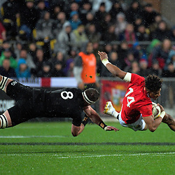 Anthony Watson is brought down by Kieran Read during the 2017 DHL Lions Series 2nd test rugby match between the NZ All Blacks and British & Irish Lions at Westpac Stadium in Wellington, New Zealand on Saturday, 1 July 2017. Photo: Dave Lintott / lintottphoto.co.nz
