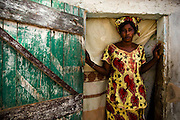 Ami Camara stands in the doorway of her home in the Medina Gounass neighborhood of Guediawaye, Senegal on Thursday April 30, 2009. Camara lost of seven-year-old son Aba Dione six weeks ago when the drowned in a pond concealed by a floating, thick layer of garbage.(Olivier Asselin for the New York Times)