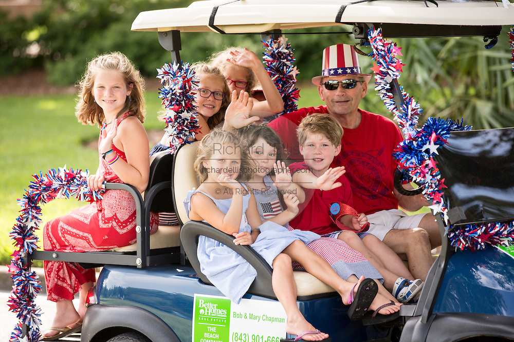 Residents of Daniel Island celebrate Independence Day early with a bicycle and golf cart parade July 3, 2013 in Charleston, SC.
